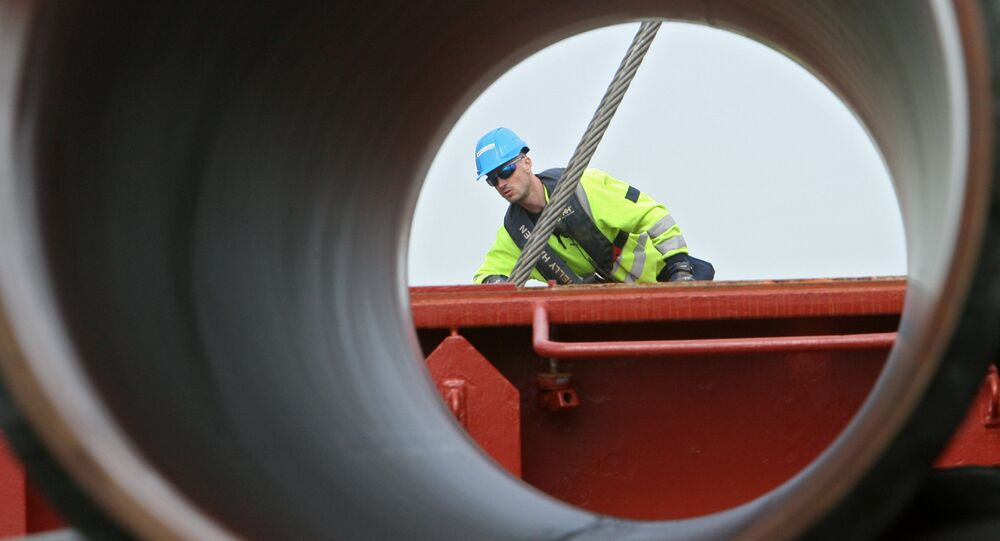 Worker checks pipes to be used in constructing the Nord Stream natural gas pipeline.