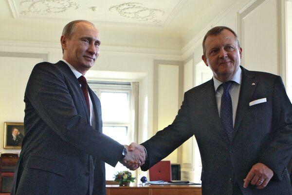 Russian Prime Minister Vladimir Putin and his Danish counterpart Lars Lokke Rasmussen - Sputnik International