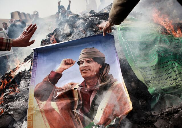 The picture of Muammar Gaddafi being burned