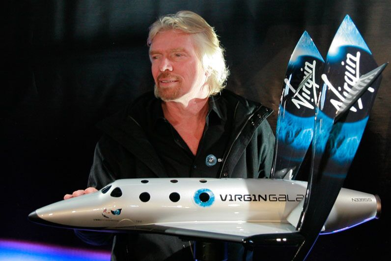 Richard Branson with SpaceShipTwo rocket plane first model.
