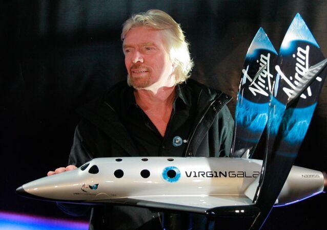 Richard Branson with SpaceShipTwo rocket plane first model.