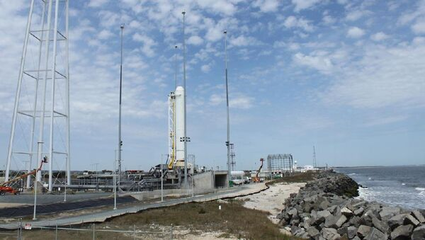 The company will continue the resupply contract with NASA even while the investigation into the crash is still underway, according to a press release.  Above: The first stage of Orbital Sciences Corporation's Antares rocket stands in launch position during pathfinder operations at NASA's Wallops Flight Facility and the Mid-Atlantic Regional Spaceport. - Sputnik International