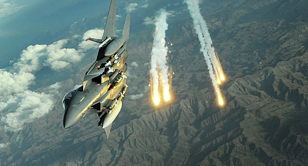 An F-15E Strike Eagle deploys flairs during a mission over Afghanistan