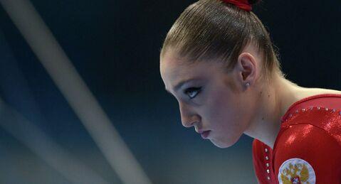 Russias Aliya Mustafina repeats as Olympic champion in