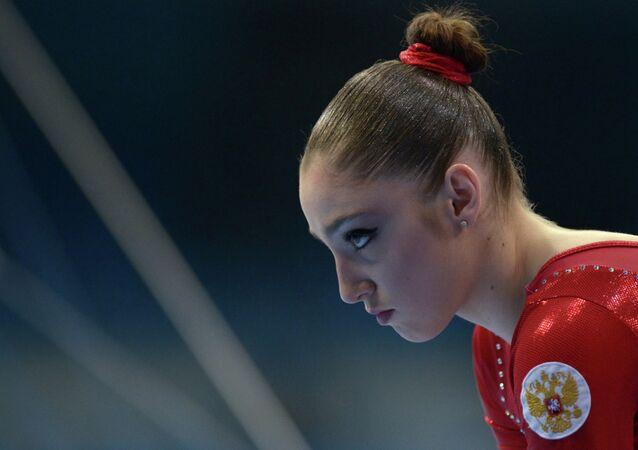 Russian artistic gymnast Aliya Mustafina scored a gold medal.