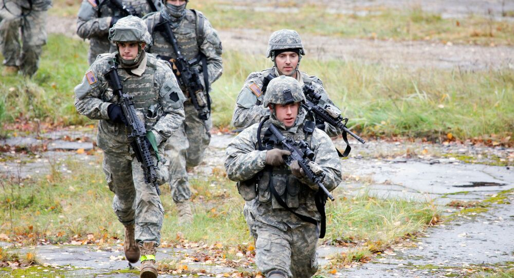 US Soldiers take part in a cordon and search exercise at the Adazi Training Area, Latvia