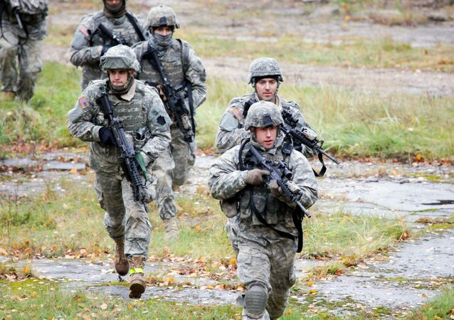US Soldiers take part in a cordon and search exercise at the Adazi Training Area, Latvia.