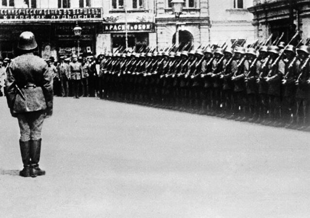 German units during a parade in occupied Ukraine during World War II.