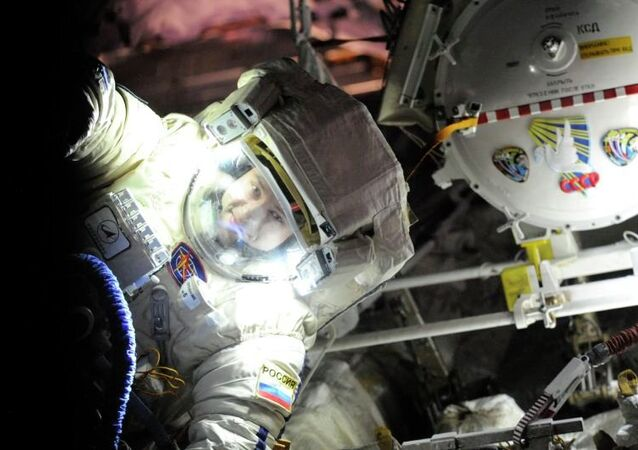 """Russian cosmonaut Alexander Misurkin conducts a check of his spacesuit, """"Orlan-MK,"""" before his Friday spacewalk."""