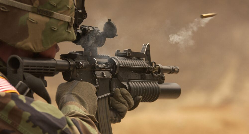 A US Army soldier fires an M-4 rifle (File photo)