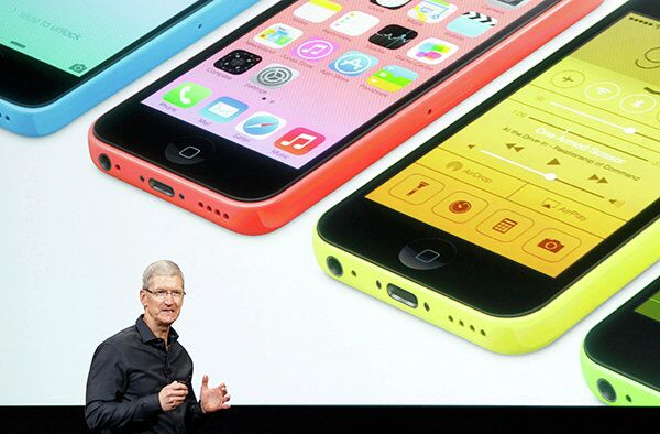 Apple Inc CEO Tim Cook talks about their new products during Apple Inc's media event in Cupertino, California September 10, 2013.