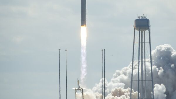 The Antares rocket and Cygnus spacecraft take off from the NASA Wallops Flight Facility in Virginia on Wednesday. - Sputnik International