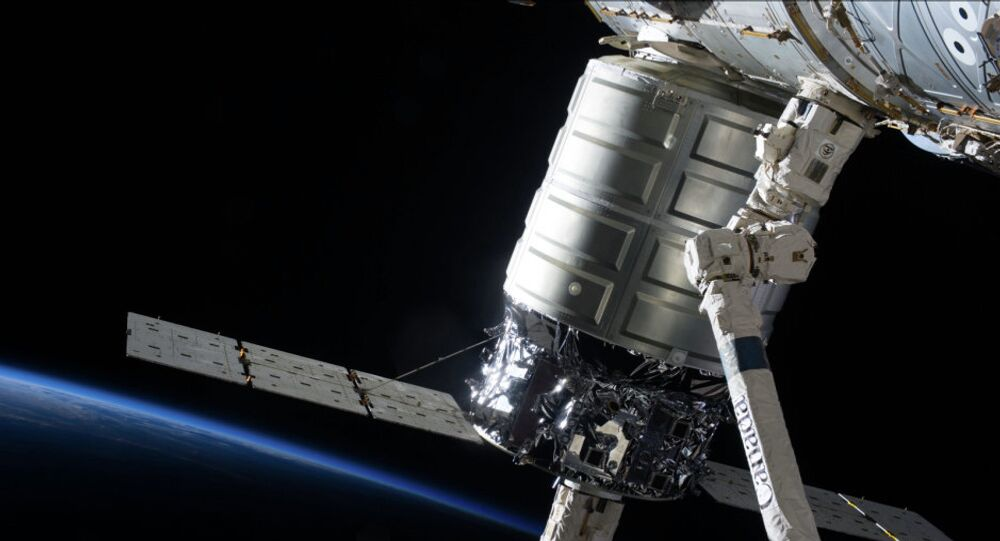 The first Cygnus commercial cargo spacecraft built by Orbital Sciences, shown here in the grasp of the International Space Station's (ISS) robotic arm, deberthed from the ISS Tuesday and headed for a fiery end over Earth.