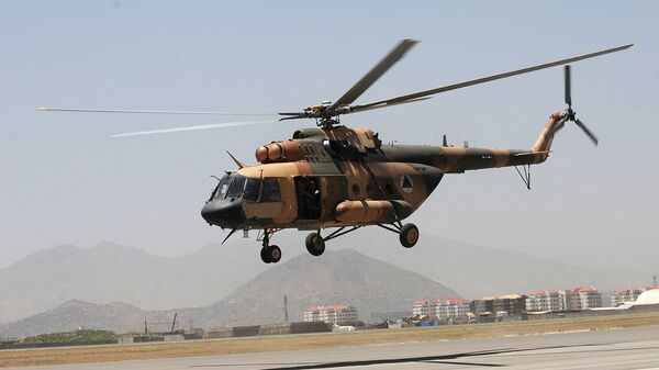 An Afghan Mi-17 helicopter takes off for an air-assault training flight from Kabul International Airport, Afghanistan - Sputnik International