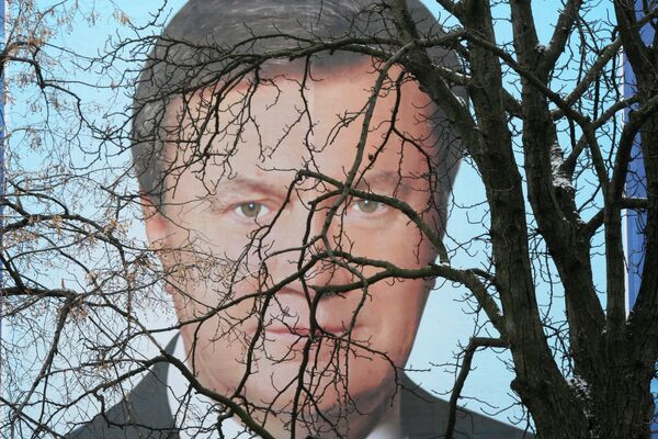 Banner with Ukrainian President Viktor Yanukovych's portrait - Sputnik International