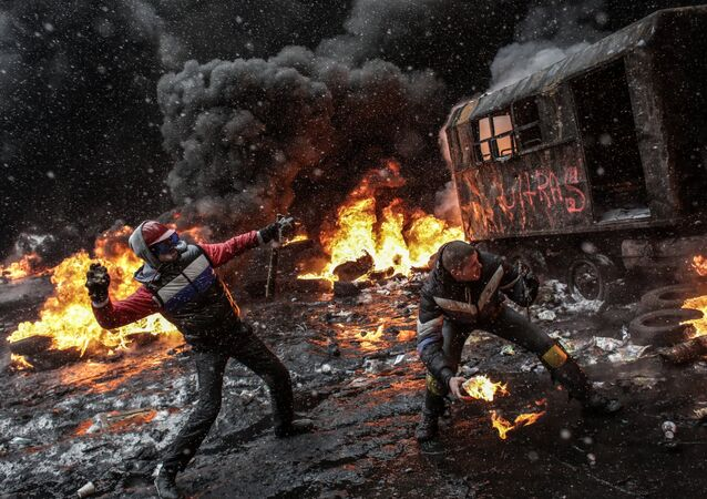Rioters throw rocks and molotov cocktails at riot police in Kiev, January 22, 2014