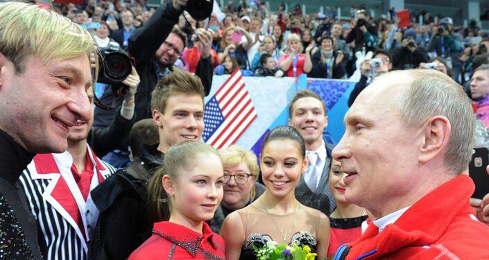 February 9, 2014. Russian President Vladimir Putin congratulates Russian athletes during a visit to a figure skating competition at the XXII Olympic Winter Games in Sochi. From left: Evgeni Plushenko, Yulia Lipnitskaya, Nikita Katsalapov and Yelena Ilyinykh.