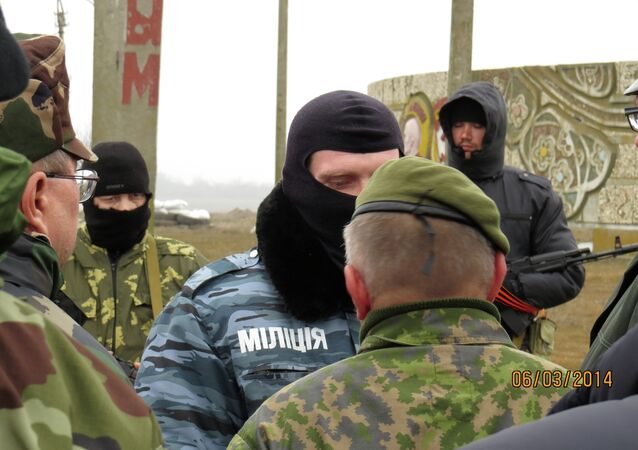 Military visitors from OSCE participating States negotiate for entry into the Crimea region