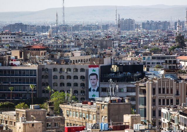 A portrait of Syrian president Bashar al-Assad on the wall of a building in central Damascus (File)