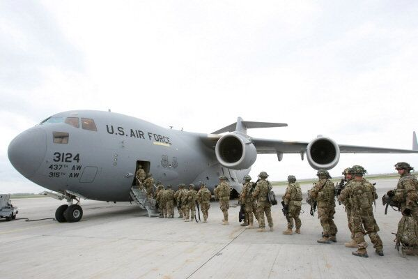 American servicemen prepare to board a military aircraft bound for Afghanistan in Manas airport in Kyrgyzstan in 2011.
