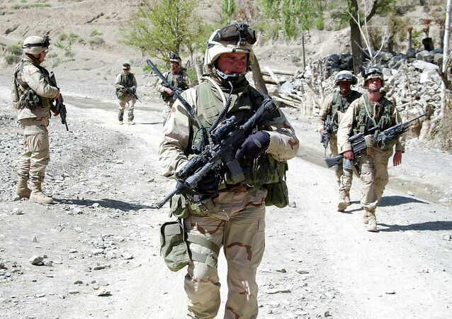 Soldiers of 27th Infanrty, 25th Infantry Division (L) pull out of Gyan village after the mission, Afghanistan, April 05, 2004. (US Army photo by SPC Gul A Alisan) (Released)