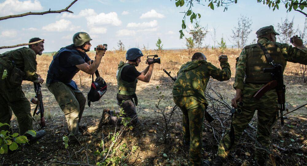 Journalists and eastern Ukrainian militia near the town of Mariinovka