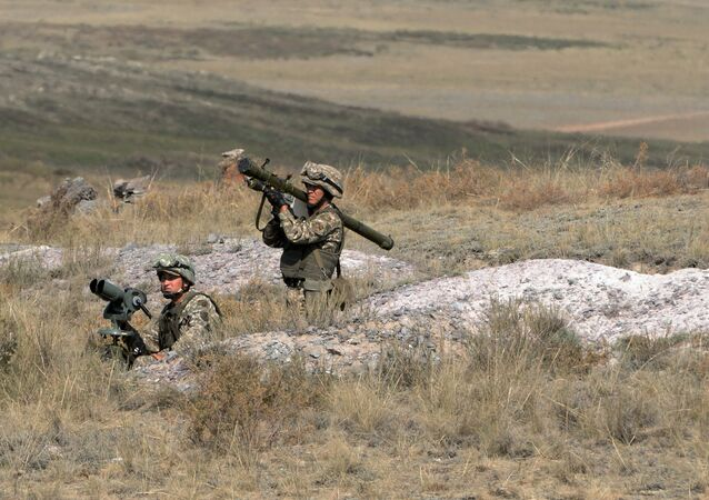 A soldier with a man-portable air-defense system during military exercises.