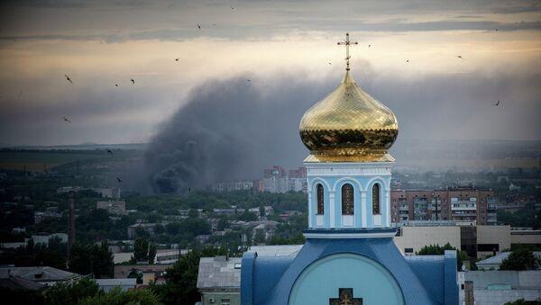 Southeastern city of Luhansk in Ukraine after artillery attack by Ukrainian army - Sputnik International
