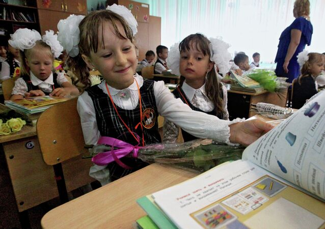 First-formers with their first text-books at the first lesson of the new school year at a Vladivostok's secondary school.