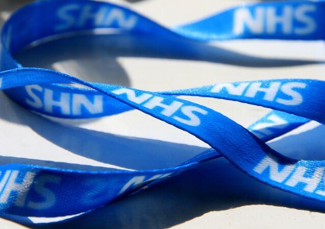 A fetching NHS blue lanyard.