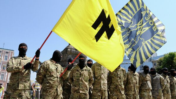 Fighters of the batallion Azov of the Ukraine's National Guard before leaving Kiev for participating in the punitive operation in Donbas. - Sputnik International
