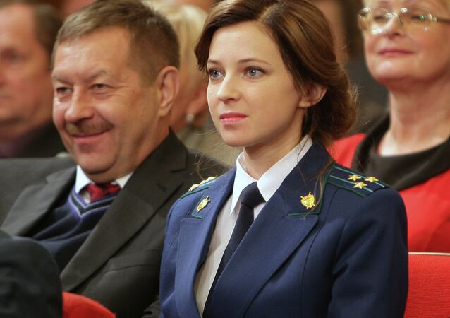 Crimean Prosecutor General Natalya Poklonskaya (center) has revealed that Kiev's hostility to her appointment last March included death threats and threats of jail time.