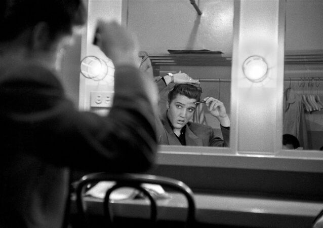 March 17, 1956. Backstage at the Dorsey Brothers 'Stage Show' rehearsal. One of the first Alfred Wertheimer's pictures of Elvis.