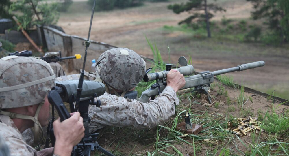 A US Marine takes aim at a long range target at the live fire range on Base Camp Adazi, Latvia on June 15, 2012