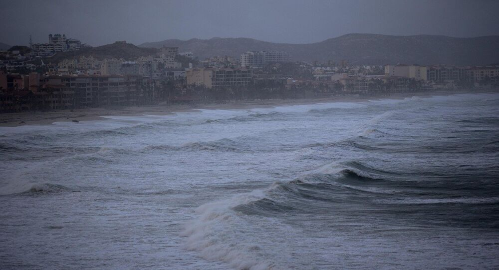 Large waves and heavy clouds near as Tropical Storm Polo approaches San Jose de los Cabos, Mexico, Saturday, Sept. 20, 2014