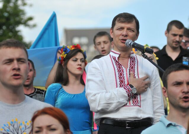 """Oleh Lyashko, the leader of Ukraine's Radical Party, savagely attacked a road sign with the message that read """"I'm Russian and I'm Proud."""""""